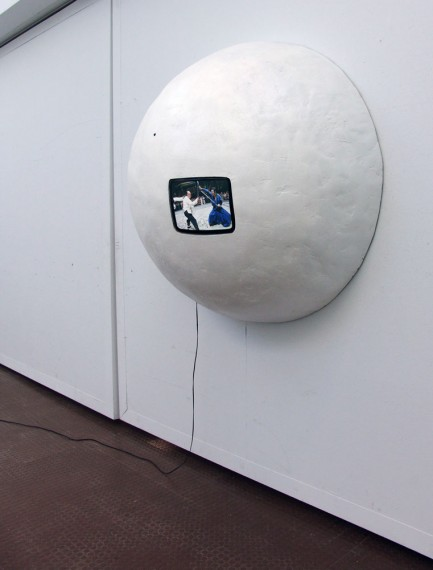 "radius . 5' x 2.5' x 5' . fiberglass, 13""CRT, rubber, paint . 2003"